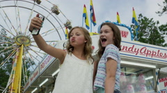 Low angle medium slow motion shot of girls taking self-portrait with cell phone Stock Footage