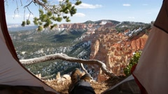 Tourist sitting in the tent, view of Bryce Canyon, Utah Stock Footage