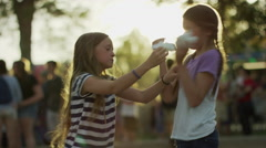 Medium slow motion shot of girls playing with cotton candy / Pleasant Grove, Stock Footage