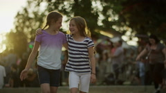Medium slow motion tracking shot of girls walking in park / Pleasant Grove, Stock Footage