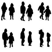Vector silhouette of children in raincoats. Stock Illustration