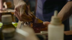 Man Lute Maker Artisan Changing String To Guitar Stock Footage