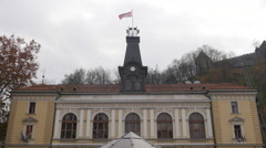 Flag waving on top of the Performing Arts Theater in Ljubljana - stock footage