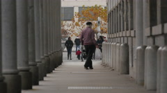 Old man with grey hair walking by the Central Market Building in Ljubljana Stock Footage