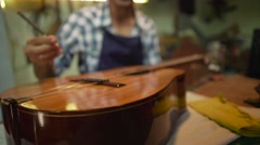 Man Lute Maker Artisan Tuning Guitar With A Diapason Stock Footage
