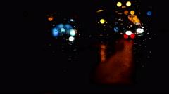 Timelapse of defocused night traffic lights through wet windscreen Stock Footage