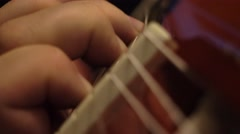 Macro shot of an acoustic guitar - stock footage