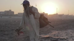 Old beggar from Pakistan collecting stuff for recycling Pakistan Stock Footage