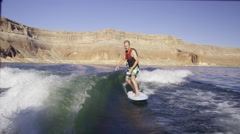 Wide slow motion shot of surfer falling in churning water / Lake Powell, Utah, - stock footage