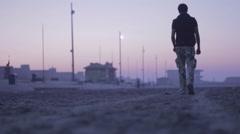 Man walking on the beach in karachi Stock Footage