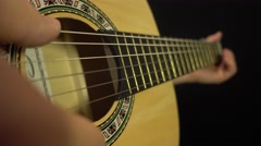 Basic strumming the guitar strings - stock footage