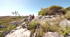Young energetic hiker couple hiking on mountain in nature - stock footage