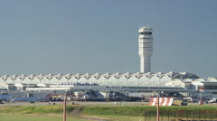 Wide shot of traffic control tower at airport / Washington D.C., District of Stock Footage