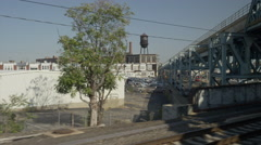 Wide shot of cityscape from train tracks / New York, New York, United States Stock Footage