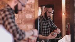 Barber in Barbershop preparing shaving cream Stock Footage