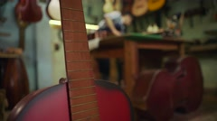 Man Lute Maker Artisan Storing Classical Guitar In Case - stock footage