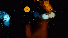 Defocused night traffic lights through wet windscreen Stock Footage