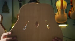 Man Lute Maker Artisan Inspecting Details Of Guitar Wooden Body - stock footage