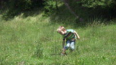 Child scratching his leg in nature Stock Footage