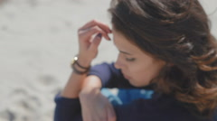 She sadly walks along the beach of the Black Sea in anticipation of - stock footage
