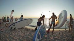 Beginning of Competition on Sup-Surfing. Several Young Men Start From Shore Arkistovideo