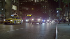 Wide shot of traffic on city street / New York, New York, United States Stock Footage