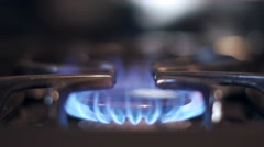 Stove top burner igniting in 4K slow motion - stock footage