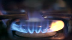 Stove top burner igniting in slow motion Stock Footage
