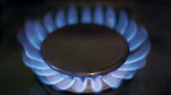Stove top burner igniting in slow motion - stock footage