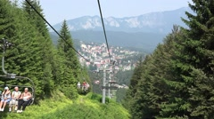 Chairlifts moving on the cables, gorgeous mountain landscape Stock Footage