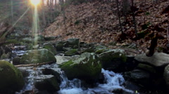 Beautiful Stream Slow Rolls with Sun in Background Stock Footage