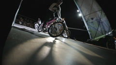 Athlete on the Bmx Bike Accelerates in the Ramp For Further Extreme Jumps From - stock footage