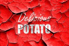 Grunge cracked Delicious potato sign Stock Illustration