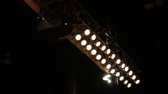 A pan across an array of stage lights Stock Footage