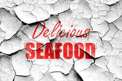 Stock Illustration of Grunge cracked Delicious fish sign