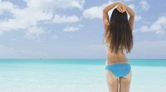 Vacation on beach woman enjoying serene luxury travel on perfect beach Stock Footage