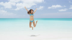 Happy beach vacation success woman jumping of joy  - perfect iconic beach travel Stock Footage