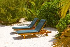 Sunbed on Maldives beach Stock Photos