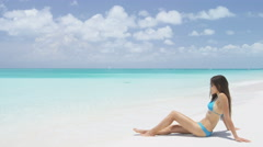 Suntan woman relaxing on summer beach vacation at tropical luxury destination Stock Footage