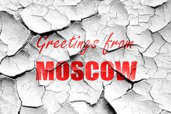 Grunge cracked Greetings from moscow - stock illustration