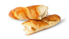 Two pieces of French baguette crosswise Stock Photos