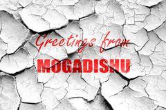 Grunge cracked Greetings from mogadishu Stock Illustration