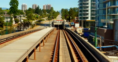 4K Above Ground Sky Train goes into Subway Tunnel Stock Footage
