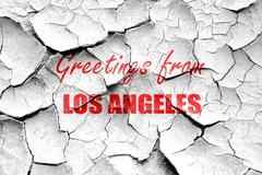 Grunge cracked Greetings from los angeles - stock illustration