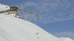 People riding on chairlifts at Kitzbühel ski resort Stock Footage