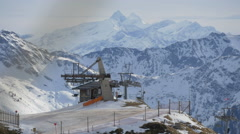 Chairlifts running and mountains at Kitzbühel ski resort Stock Footage