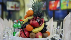 Decorative festive table with fruit - stock footage