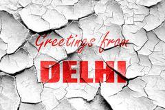 Grunge cracked Greetings from delhi - stock illustration
