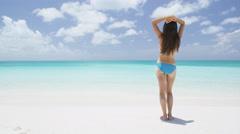 Beach vacation travel bikini woman in Caribbean - beautiful sexy babe Stock Footage
