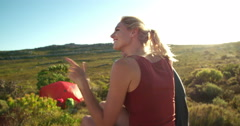 Camping couple looking at mountain and tent in wild outdoors Stock Footage